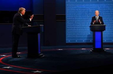 Joe Biden and Donald Trump standing on stage