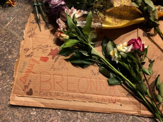 "Flowers are placed on a sign that reads ""Breonna"""