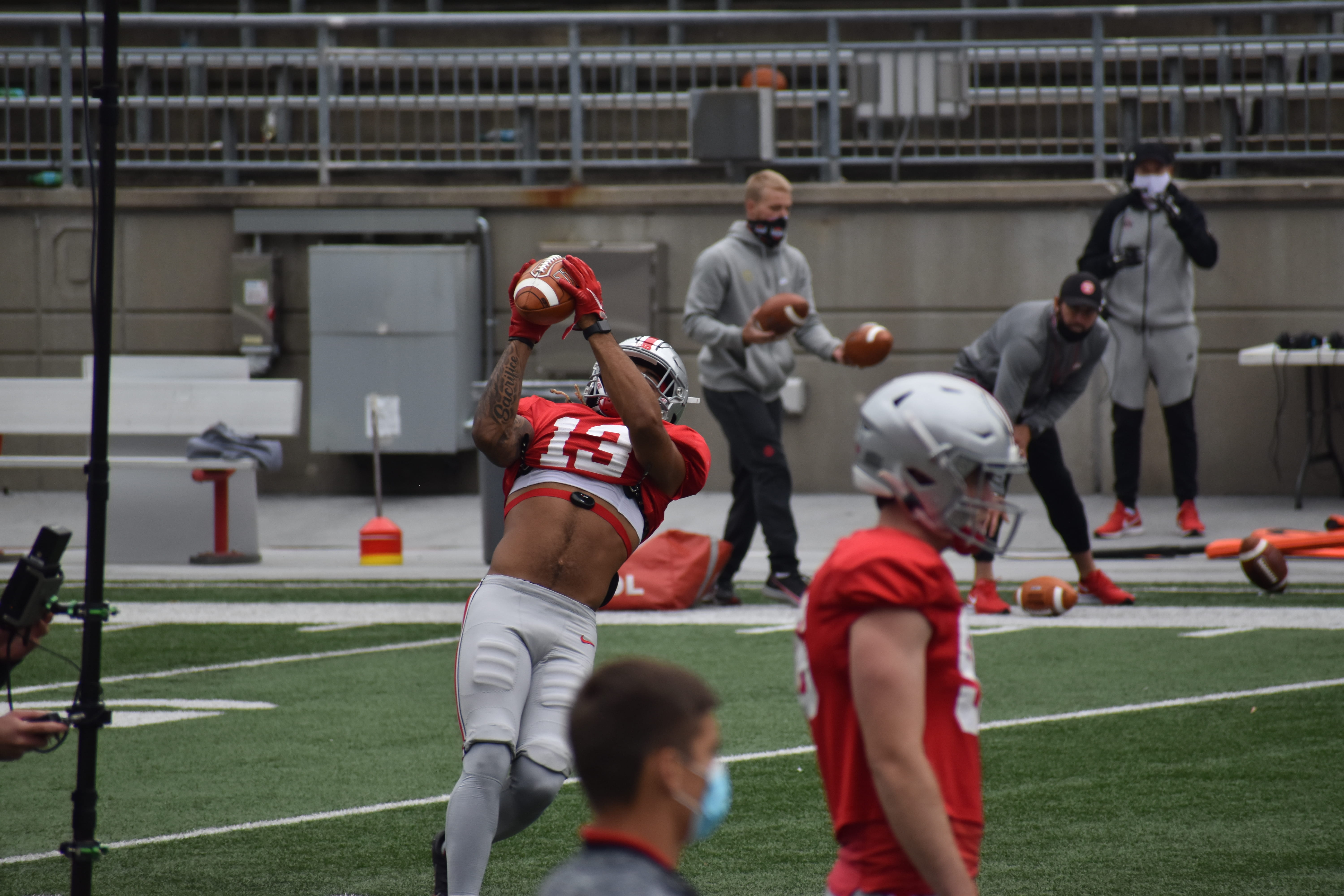Gee Scott Jr. is falling back to catch a pass
