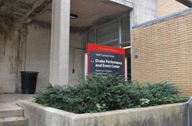 the drake performance center sign in front of the door to the building