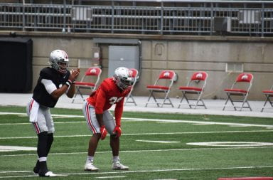 Justin Fields and Master Teague III stand waiting for the ball to be passed to Fields
