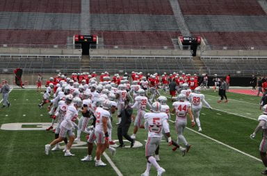 Ohio State football players warming up ahead of practice.