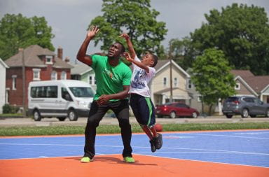 A LifeSports camper and counselor shooting hoops