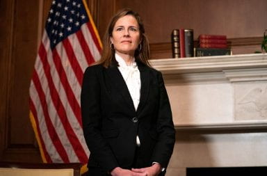 Amy coney barrett stands for a portrait