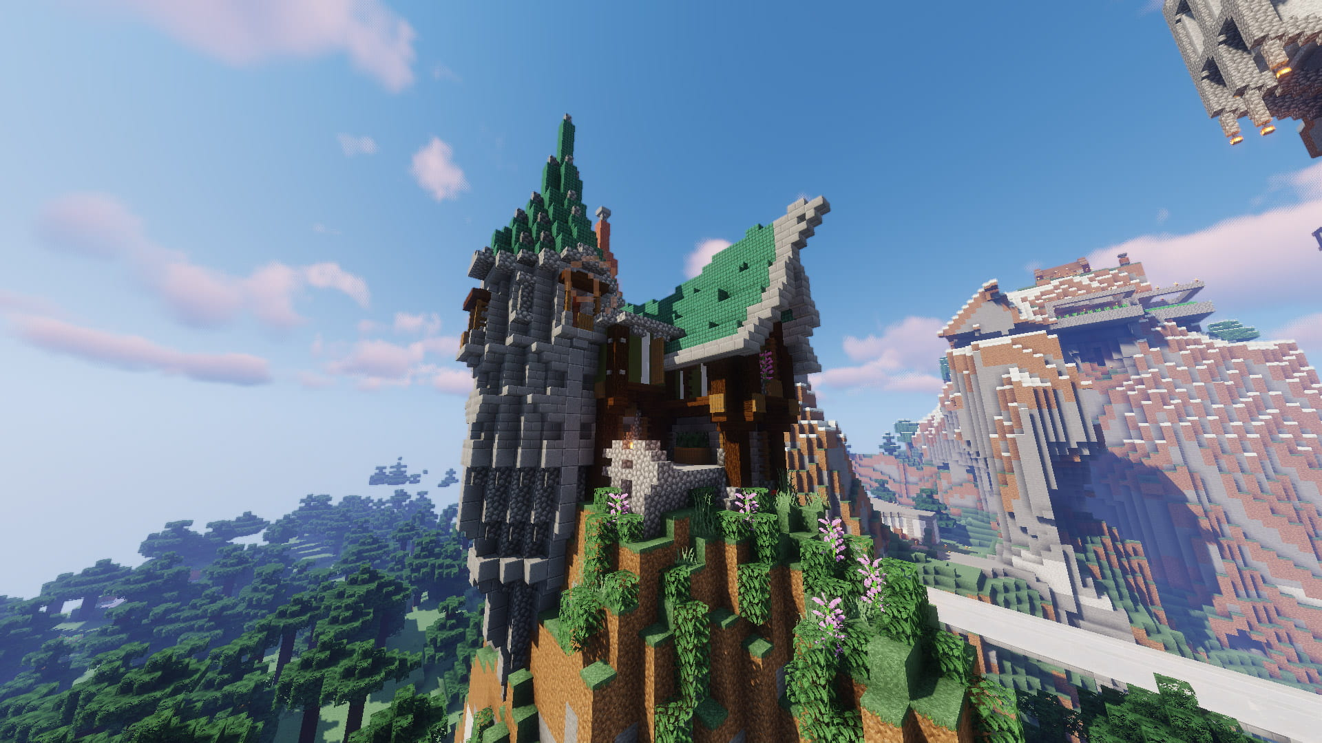 A landscape picture of a Minecraft house with a large expansive forrest landscape behind it