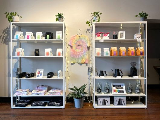 A couple of shelves display the wide array of products and items that Brioso Coffee sells in store