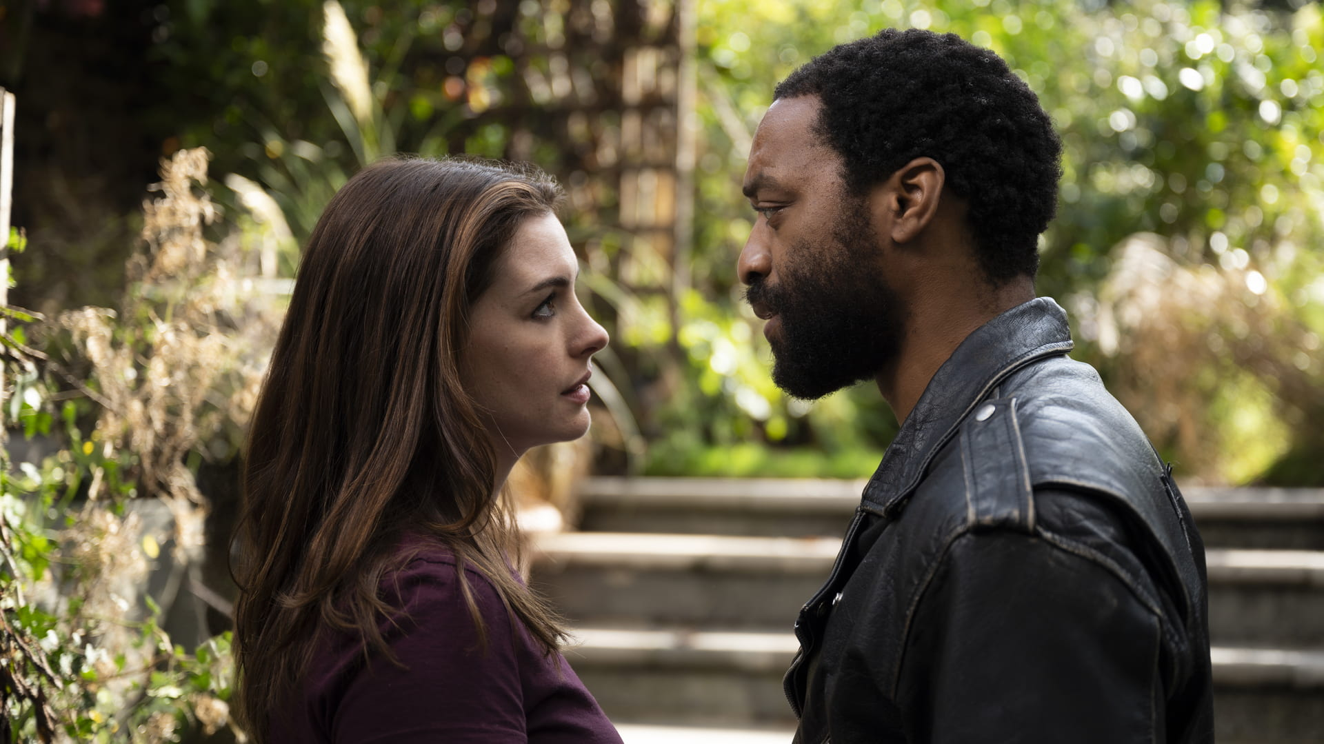 """Anne Hathaway and Chiwetel Ejiofor star at each other during a scene in """"Locked Down"""""""