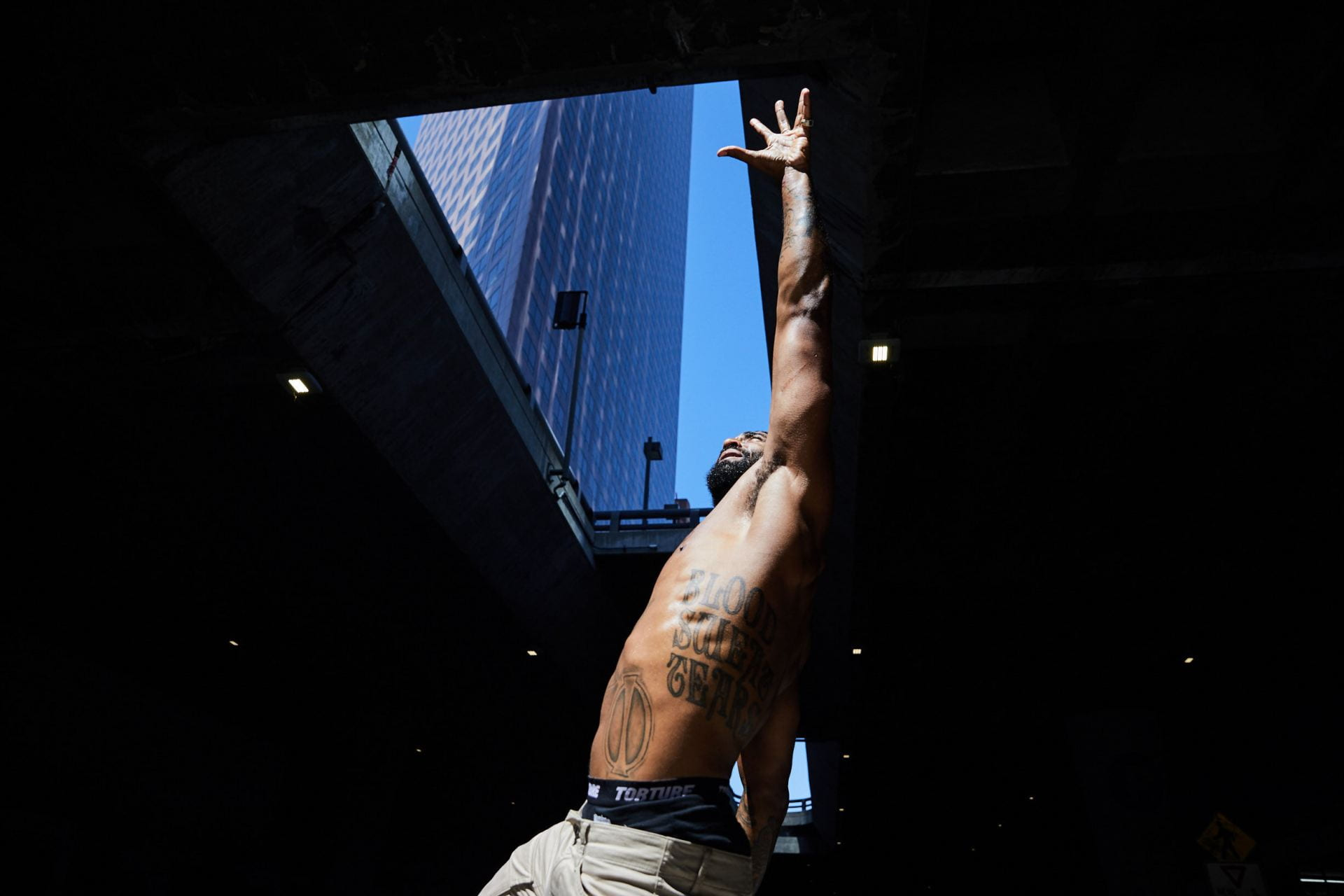 A man dances in the streets shirtless