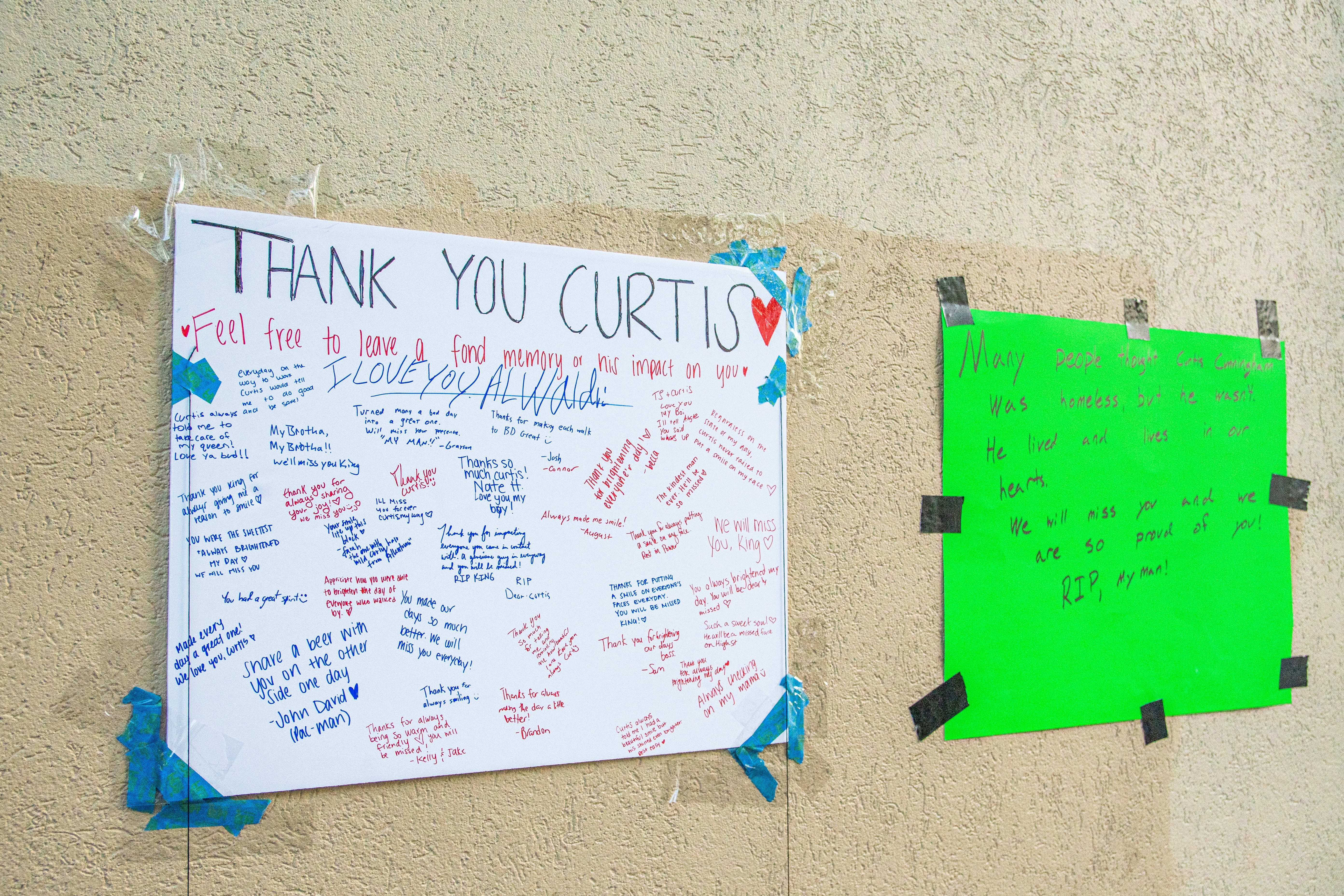Two posters outside honoring Cunningham's legacy.