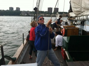 Dr. Quigley hoists the sails aboard the Clearwater sloop.
