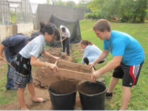 Students sifting soil for use in an experiment.