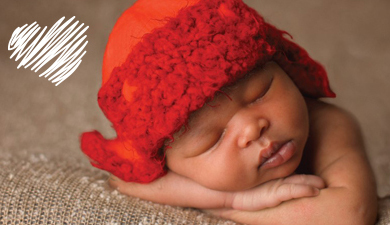 baby with knit hat