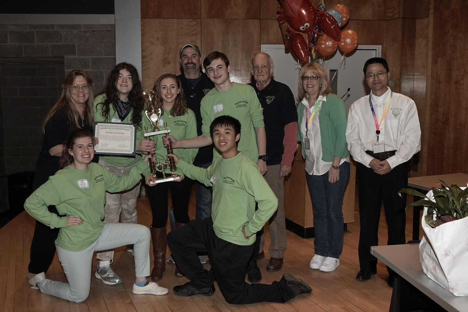 The 2018 Bay Scallop Bowl Winners - Mount Sinai High School.  Back row - left to right - Coach, Glynis Nau-Ritter, Arielle Mule, Clare Dana, Assistant Coach Andrew Matthews, Joshua Goodman, SoMAS Interim Dean Larry Swanson, Coordinators Kim Knoll and Ping Liu. Front row - left to right - Julia McElheron, Johnathan Yu