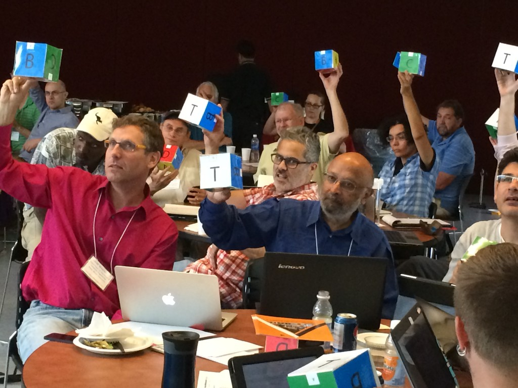 Faculty using low tech response cubes during a presentation