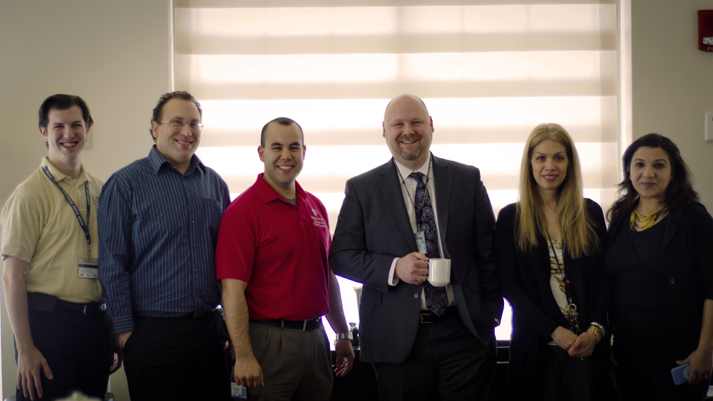 Image of staffers meeting with Stony Brook Vice President for Information Technology and CIO Cole Camplese