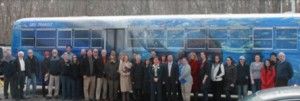 SoMAS Faculty, Staff and Students with the new SoMAS-themed bus