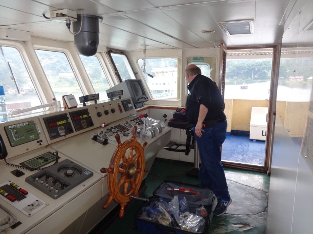 SoMAS Electronics Workshop engineer Thomas Wilson spreading his tools on the MV Serengeti ferry ready for installation of meteorological and hydrological sensors, in Mwanza, Tanzania, January 2016 (Photo credit Lwiza).