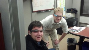 This is a photo of Jason Kanaris and Dan Fourman in Application Support for Administration testing out Google Glass
