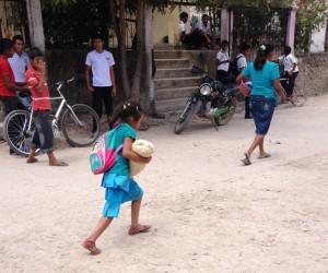Girl carrying maiz