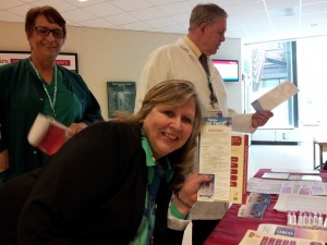 Hospital employees at Healthier U's table