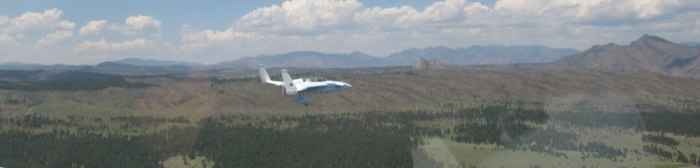Employment of the research aircraft with WASP during the BEACHON-RoMBAS campaign. In flight over Manitou Forest in Colorado.
