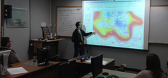 ITPA Graduate Student Michael Erickson leads a weather discussion