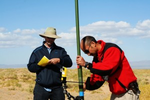 Dr. John Mak and Dr. Alex Guenther, NCAR senior scientist, taking air samples in the Gobi Desert, Mongolia;